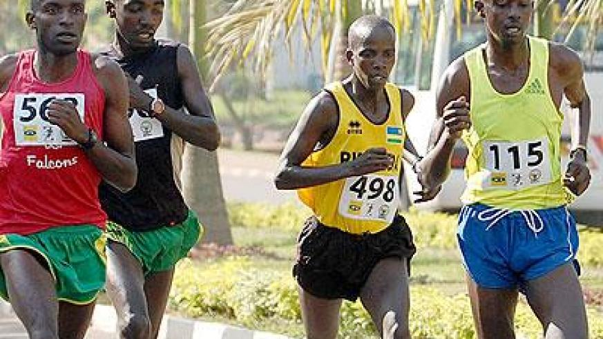 Local athletes led by Godfrey Rutayisire (115) will battle international elite runners for 2014 MTN Kigali Peace Marathon honours. (File)