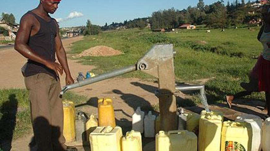 People fetch water from a borehole in Gacuriro in Kigali. Governments have the responsibility to provide clean water. (File)