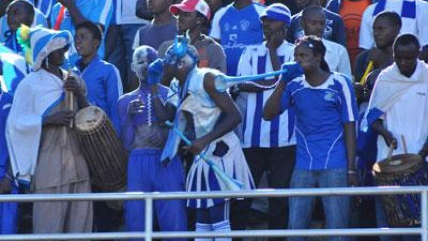 Rayon Sports cheer leader Rwarutabura (C), who holds a Rwf5000 membership card, leads fellow supporters during a league match last season. (File)