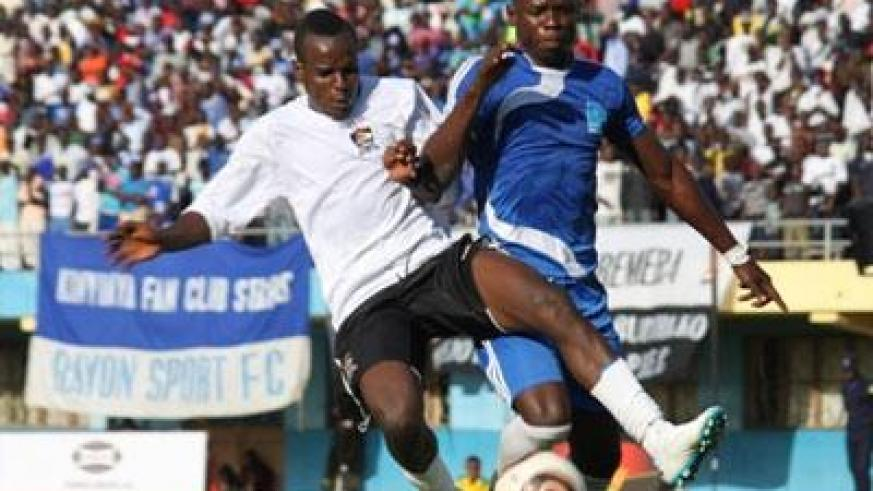 APR winger Charles Tibingana Mwesigye battles with Rayon Sports defender Hussein Sibomana during the league clash this season. (File)