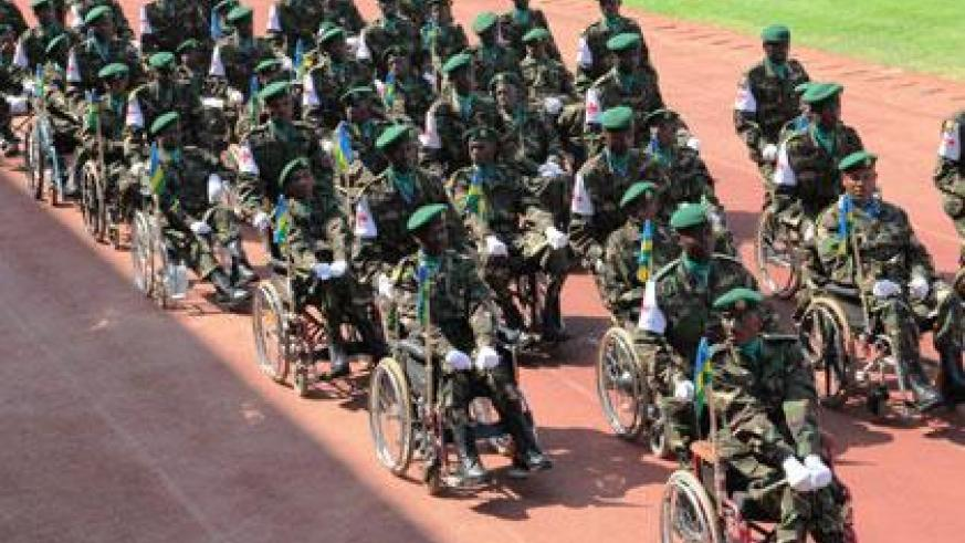Down but not out: Physically impaired soldiers mount a guard of honour during the 20th Liberation Anniversary on Friday. (John Mbanda)