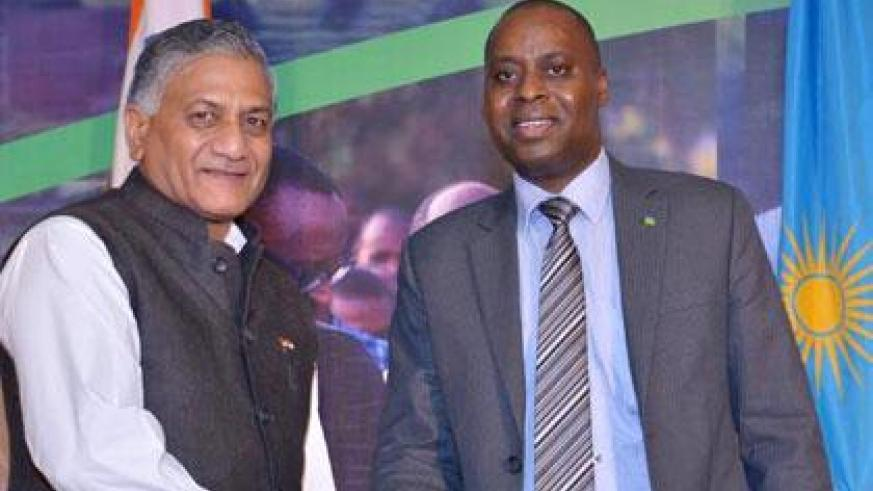 Vijay Kumar Singh, the Indian Minister of State for External Affairs, (R) shake hands with Rwanda's envoy to India, Ernest Rwamucyo, during the 20th Liberation celebration. (Courtesy)