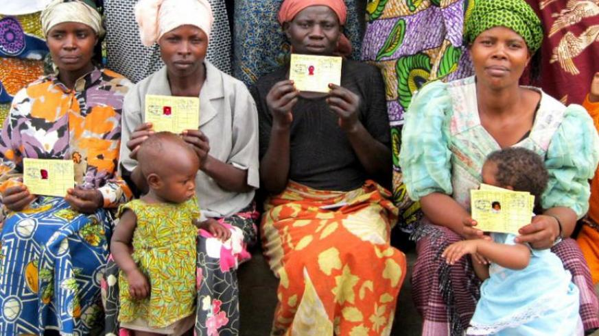 Mothers display their Mutuelle de Sante cards. Experts attribute Rwanda's performance to provision of health care to all citizens. (File)