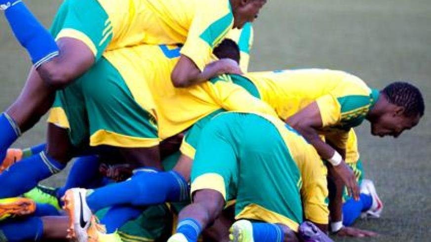 Amavubi players celebrate at the last whistle after beating Congo 4-3 on penalties following a 2-0 win in normal time. Congo had won the first leg 2-0 two weeks ago. The Team now q....