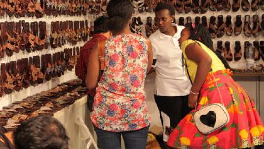 Customers at a shoe stall. Corporate exhibitors are complaining of noise. (John Mbanda)