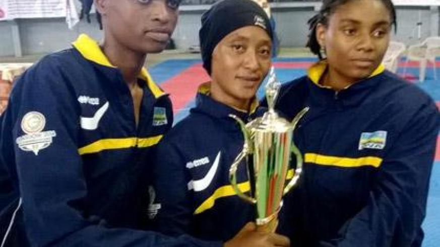 Solange and team mates Rehema Kabera and Providence Mutuyimana show off the team's Best Performance trophy. (Courtesy)