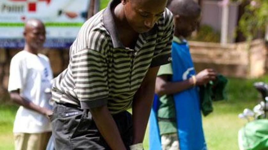 Aphrodis Nyilinkwaya is one the key players on Rwanda's national golf team. (Timothy Kisambira)