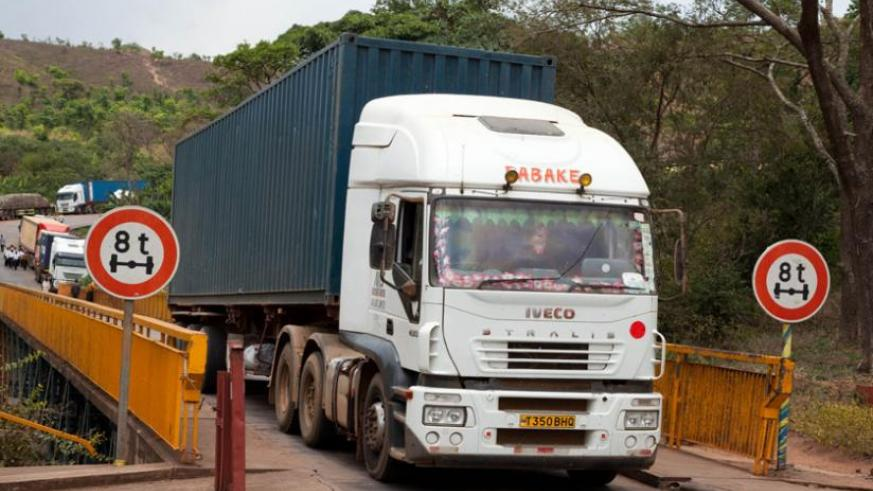 Trucks cross Rusumo border. Truck drivers have persistently complained of several non-tariff barriers along the Central Corridor. (Timothy Kisambira)