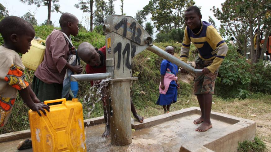 Children fetch water at a public borehole. Over 11% of city dwellers don't have access to safe water. (File)