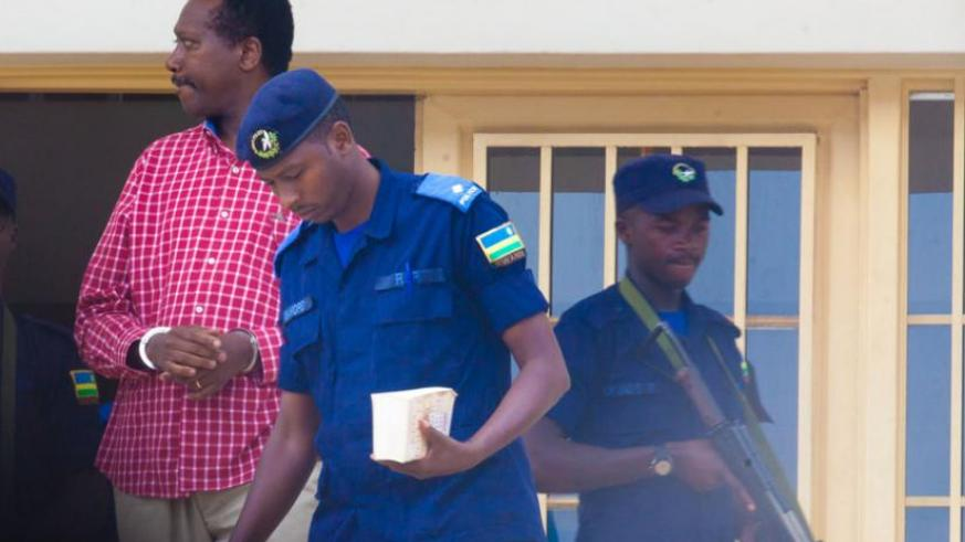 Kabuye is escorted out of the court on Monday. (Timothy Kisambira)