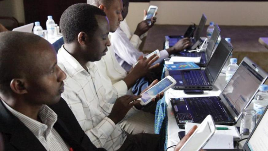 Teachers use tablets to surf the Internet at a recent workshop. Internet penetration is still low in Rwanda.  (John Mbanda)