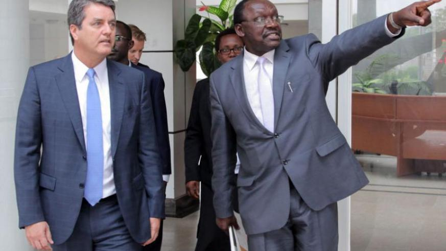 Trade and Industry minister Francois Kanimba (R) shows visiting World Trade Organisation director-general Roberto Azevêdo  around after their meeting in Kigali yesterday. (John Mbanda)