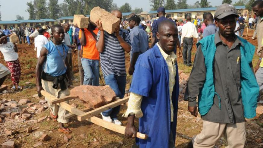 Residents of Kanombe participate in Umuganda to construct a school . (File)