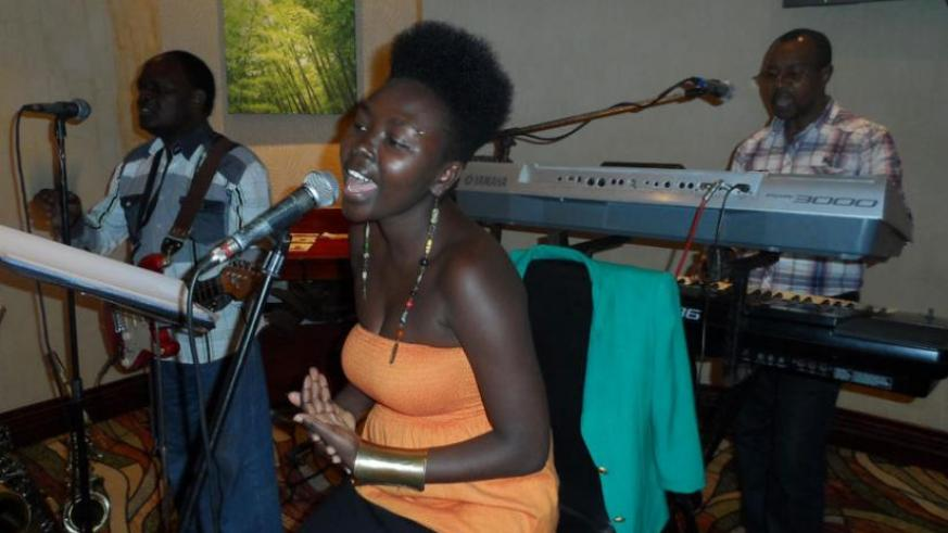 Lead singer, Prudence, sings at Serena. (Moses Opobo)