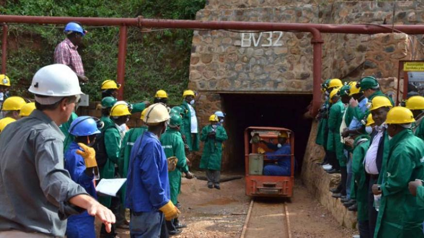 Visitors prepare to enter a tunnel at Rutongo Mines in Rulindo District last year. (File)