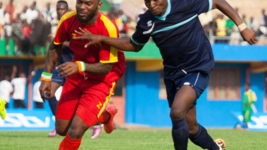 Cassa Mbungo will rely on the goals of striker Jimmy Mbaraga, right, seen here action against Pascal Wawa of El Merreikh, as he bid lead to Police FC to their first league title next season. (Timothy Kisambira)