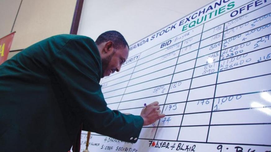A trader records deals at the local bourse. The Rwanda Stock Exchange presents huge opportunities to small-and-medium businesses. (File Photo)