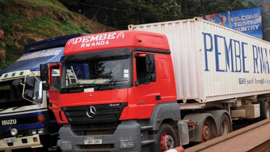 Cargo trucks await clearance at Gatuna border. The government will soon allow importation of right hand drive cargo trucks of 30 tonnes and above to support local logistics firms. (File)