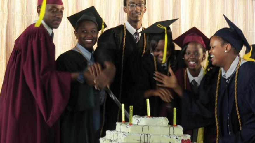 Students cut a cake at their graduation ceremony recently. Any person can do anything they put their mind to. (Courtesy)