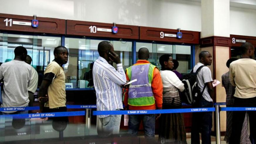 Clients at a Bank of Kigali branch queue to get served. (File)