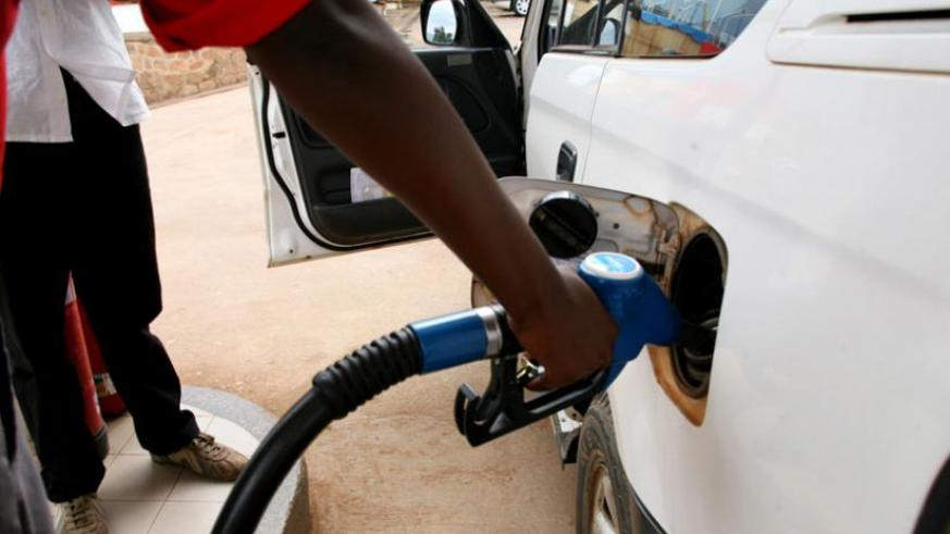 A pump attendant fuels a car in Nyabugogo. (File)