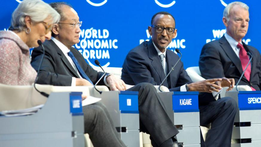 President Kagame contributes at the panel discussion that also included Lagarde (L), Yong Kim (2nd L) and Spence (R) at Davos Summit in Switzerland yesterday. (Village Urugwiro)