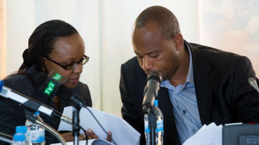 Sharon Haba (L) the permanent secretary at the Ministry of Education goes through the examination sheets with state minister in charge of TVET Albert Nsengiyumva