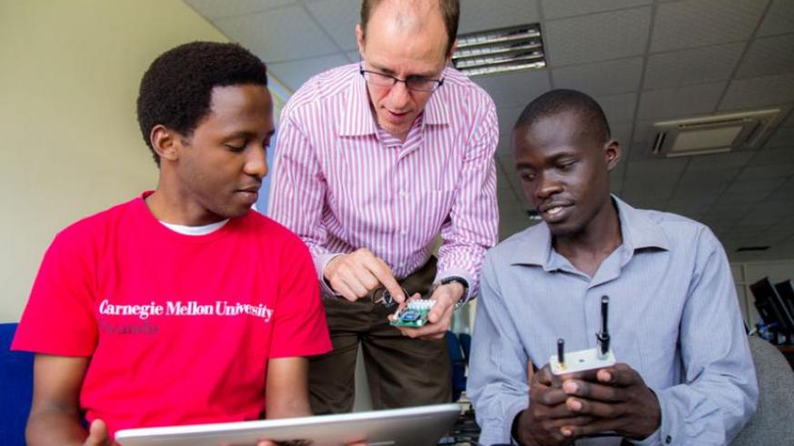 Prof. Tim Brown of Carnegie Mellon University explains to participants how 'Internet of Things' functions. (Timothy Kisambira)