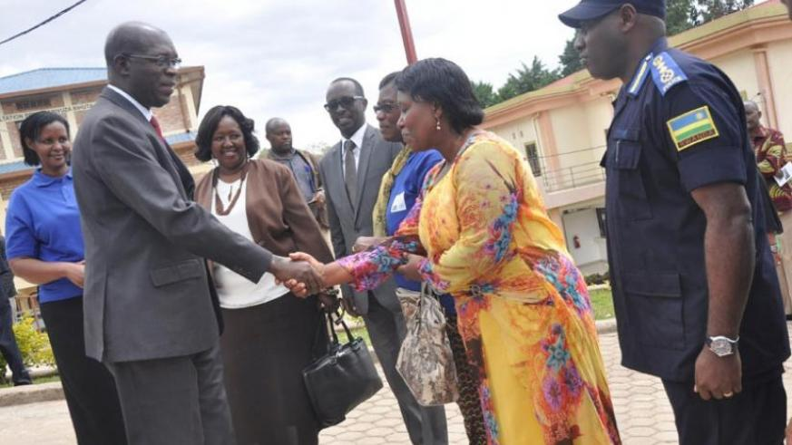 Muhanga District mayor Yvonne Mutakwasuku welcomes premier Murekezi as other government officials look on. This was during  the  launch of the national campaign against gender-based violence and child abuse yesterday. (Courtesy)