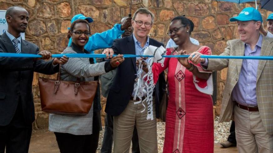 (L-R) Gasabo mayor Stephen Rwamurangwa; Imbuto Foundation's director-general Urujeni Bakuramutsa; Ikea Foundation's CEO Per Heggenes; permanent secretary for MIGEPROF Henriette Umulisa; and Unicef country representative Ted Maly cut a ribbon to officially open the Gikomero Early Childhood Development & Family Centre yesterday. (Doreen Umutesi)