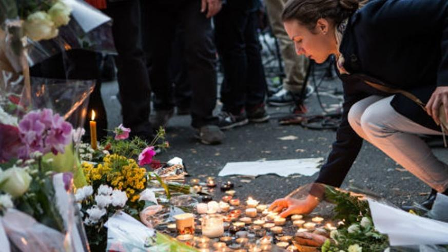 People place flowers and light candles in tribute for the victims of the Paris terror attacks. (Net photo)