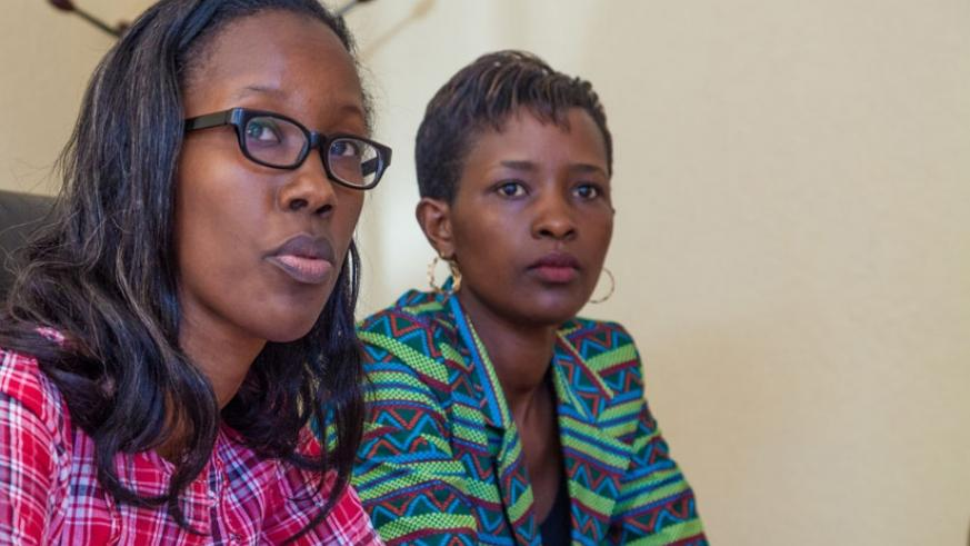 Development Women Empowerment Officer at National Women Council Yvette Muteteri (L) speaks during the news conference as Kamanzi Masabo looks on, in Kigali, on Monday. (Faustin Niyigena)