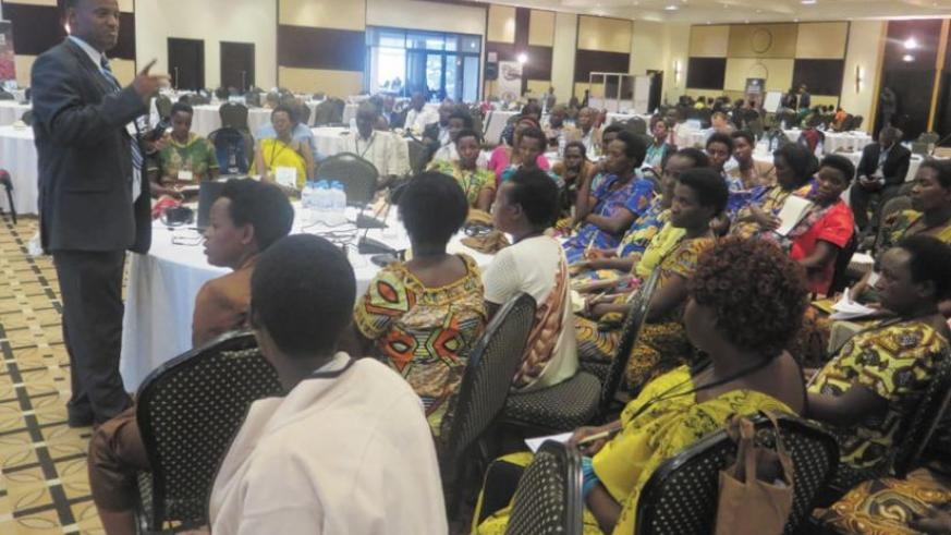 Muhimuzi speaks during the training workshop.  The women were trained in planning and budgeting in coffee production. (Michel Nkurunziza)