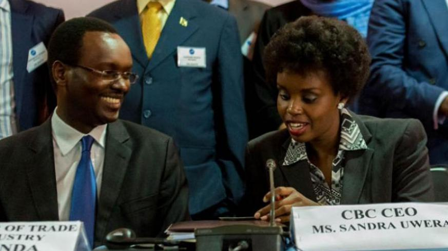 Sandra Uwera (right), the chief executive officer, COMESA Business Council, and Emmanuel Hategeka, the permanent secretary at Trade and Industry Ministry, chat during the Kigali meeting last week. (File)