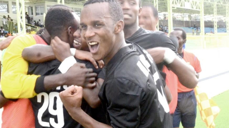 Patrick Sibomana leads his APR teammates in celebrations after Fiston Nkezingabo (#26) had scored the first goal on Saturday. (Sam Ngendahimana)