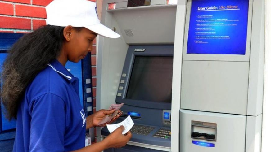 A woman withdraws money from an ATM. (File)