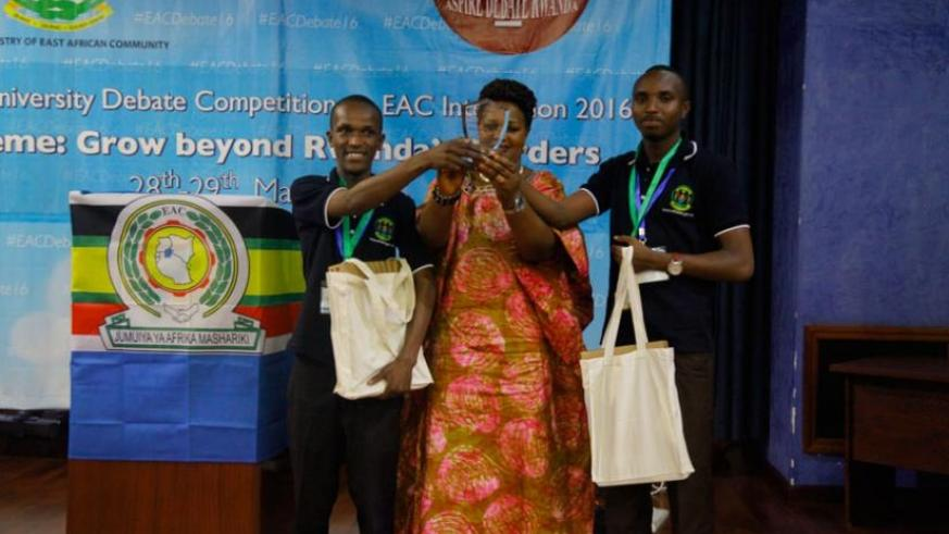 University of Rwanda – College of Agriculture & Veterinary Medicine (UR-CAVM) students receive their trophy from EALA Member Nyirahabineza at the closing ceremony. (Courtesy)