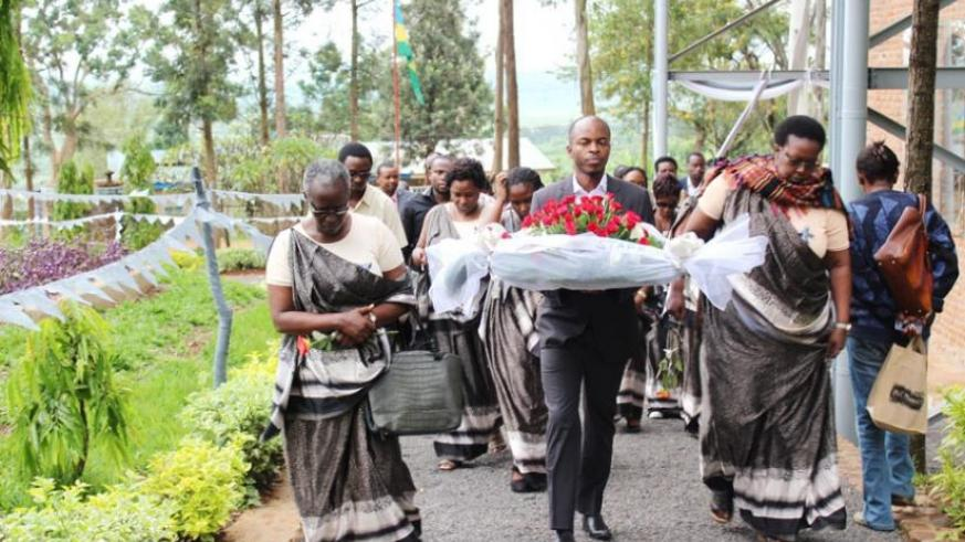 Action Aid staff arrive at Ntarama Genocide Memorial Site to pay tribute to victims of the 1994 Genocide against the Tutsi. (Frederic Byumvuhore)