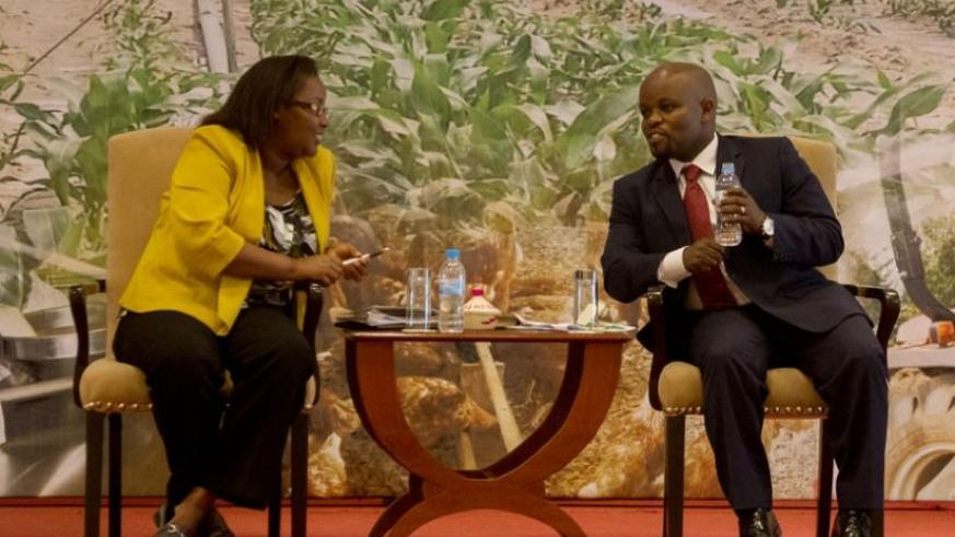 Agriculture minister Geraldine Mukeshimana (L) chats with Jean Philbert Nsengimana, the Minister for Youth and ICT, during the launch of Rwanda Youth in Agribusiness Forum in Kigal....