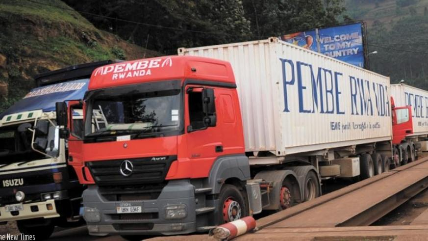 Trucks at Gatuna border post awaiting clearance. The COMESA yellow card will help cover third-party liabilities and medical expenses for the driver of the vehicle and his passenger....