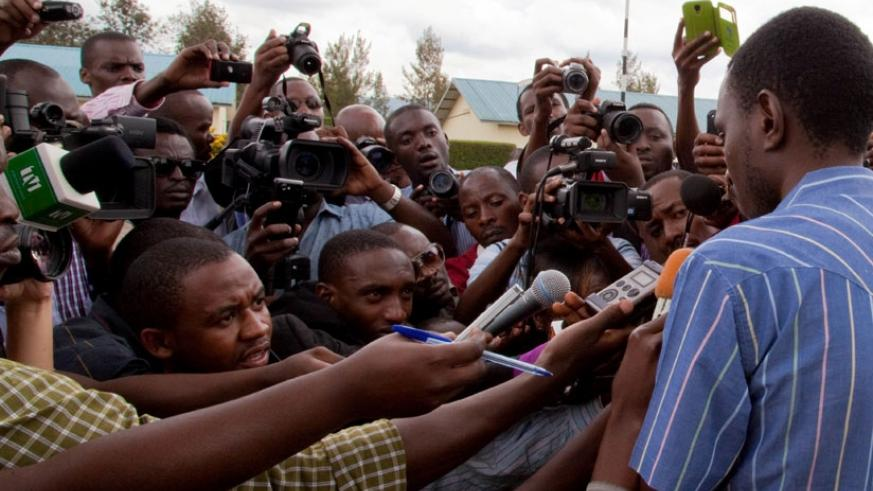 Journalists interview a suspect at Kacyiru Police headquarters last year. (Timothy Kisambira)
