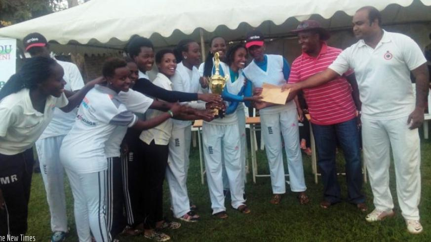 Charity CC players receive the trophy from RCA boss Charles Haba (2nd right) after defeating  White Clouds CC in the final on Sunday. (Pontian Kabeera)