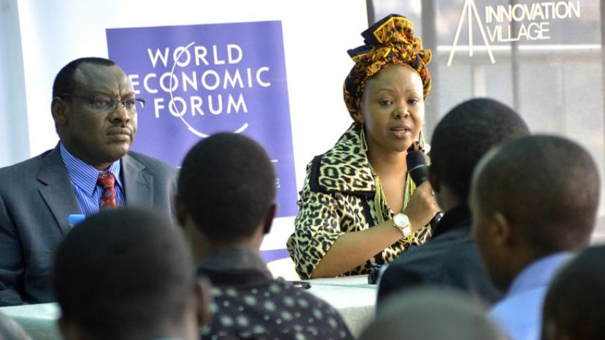 Finance and Economic Planning minister Claver Gatete (L) and Elsie Kanza, the head of WEF Africa division and member of the Executive Committee of World Economic Forum, address the....