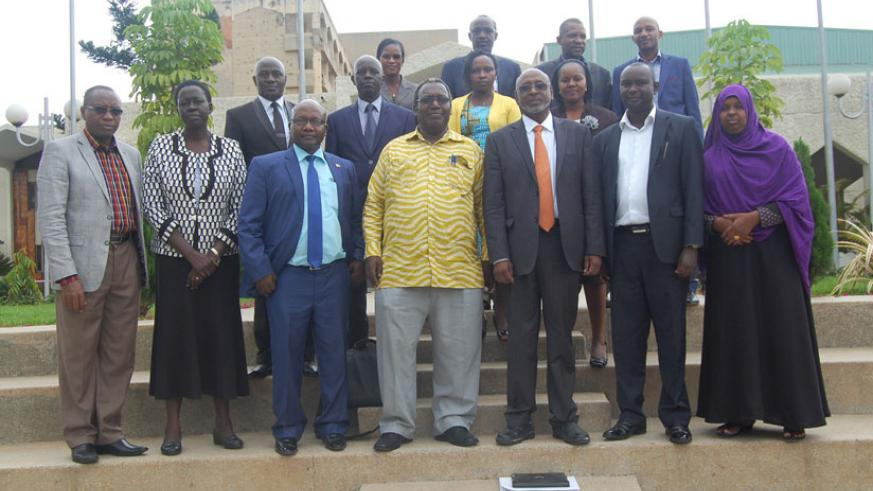 EAPAC Chairperson Juvenal Nkusi pose for a group photos  with members of the executive committee of EAPAC. (Courtesy)