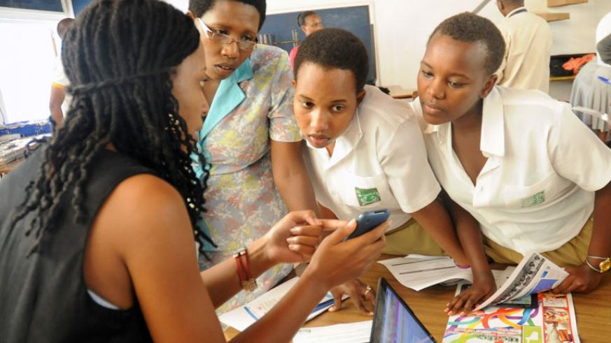 Clarisse Iribagiza (L), CEO of HeHe Limited explains to female students how an ICT software works. (File)