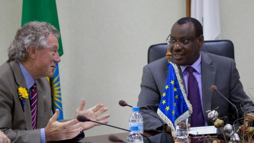 The Head of the European Union Delegation to Rwanda, Amb. Michael Ryan (L), chats with Finance and Economic Planning minister Claver Gatete after signing a financing agreement wort....