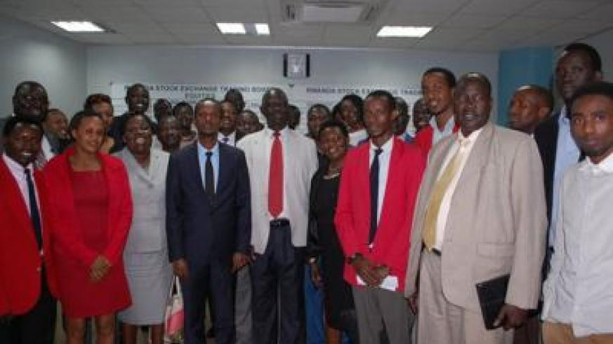 CMA's Bundugu (fourth left) and Sabuni (centre) pose for a picture with other South Sudanese officials and market dealers at the local bourse trading floor. The officials praised t....