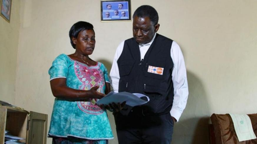 A community health worker explains to Dr Babatunde how they provide family planning services to community members  in Rwamagana District on Tuesday. (Courtesy)