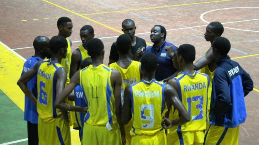 Head coach Moise Mutokambali gives instructions to his players in a league match against Espoir last week. The team leaves for the US on Sunday for a series of friendly games. (Peter Kamasa)