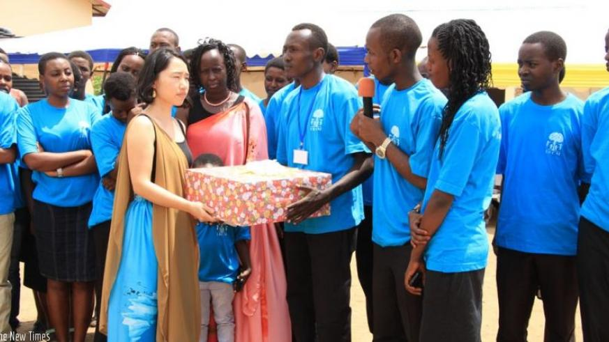 Some of the students give presents to their benefactors, including Yuiko. (Kelly Rwamapera)